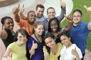 Students with their thumbs up